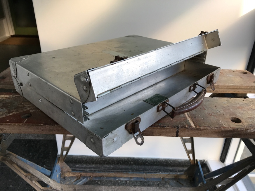 The fold up lid to enable boards to be easily removed or inserted