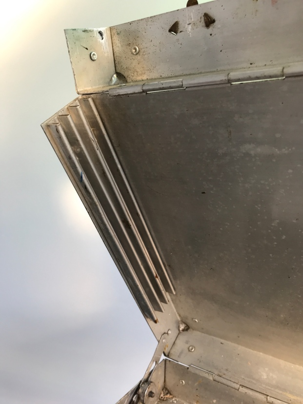 The grooves for ssliding boards into