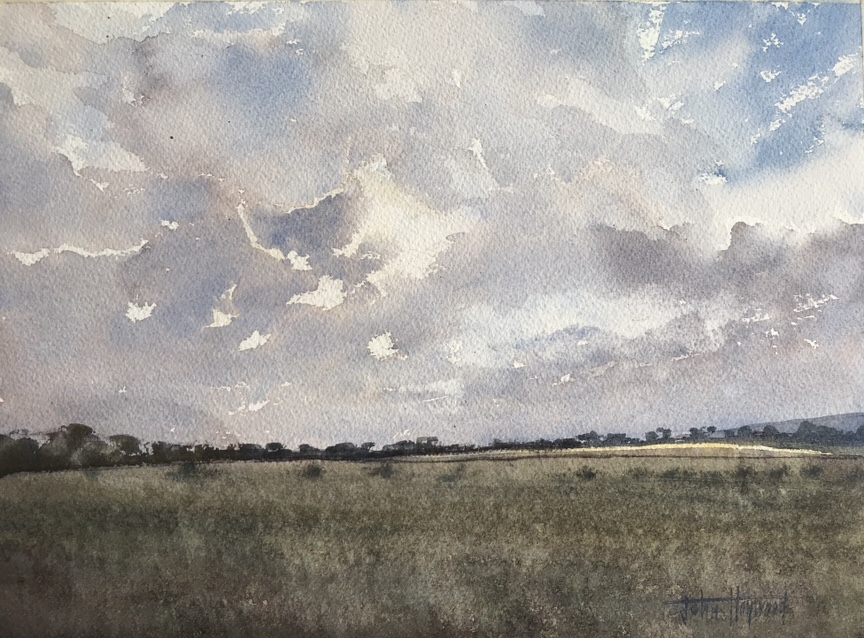 Watercolour painting of the sun going down over the South Downs by watercolour artist John Haywood