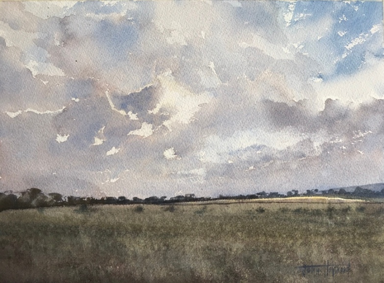 Watercolour painting of the sun setting near the South Downs by John Haywood