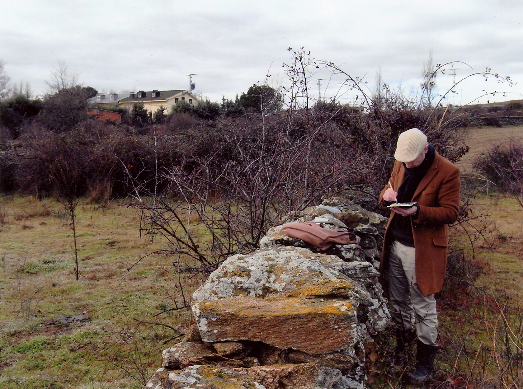 Photograph of watercolour artist John Haywood sketching plein air in the hills outside Madrid