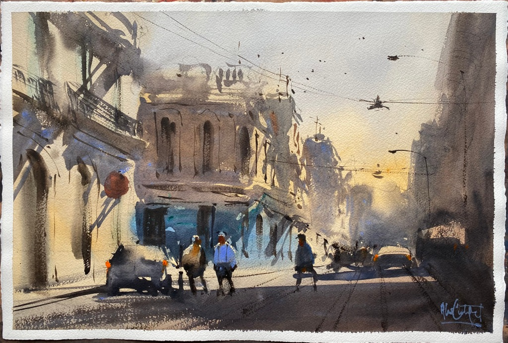 Finishes demonstration watercolour painting by Alvaro Castagnet of a sunlit street in Montevideo